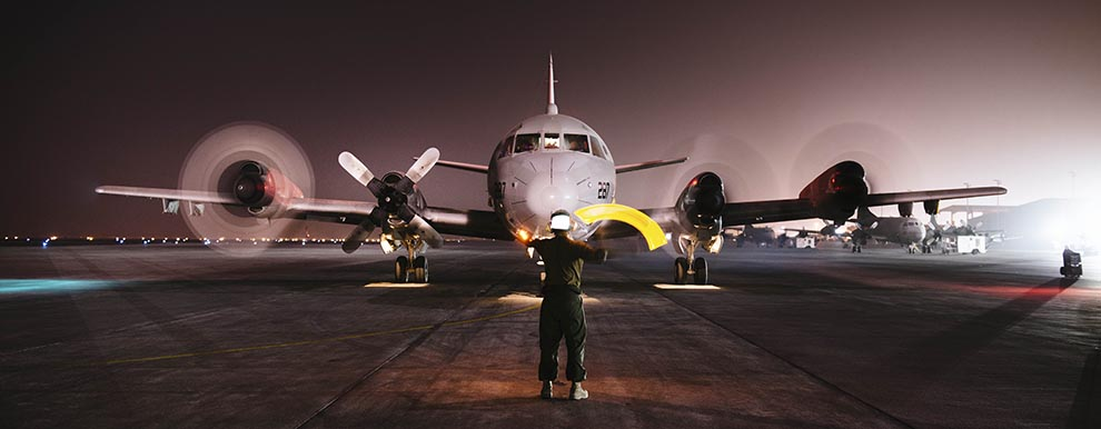 Aviation Electrician's Mate 2nd Class Mack Sanchez conducts turns on a P-3C Orion.