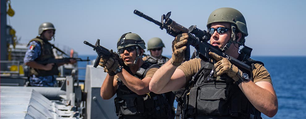 Members assigned USS Jason Dunham tactically move aboard an Egyptian Naval Force supply ship during exercise Eagle Salute 18.
